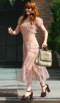 Florence and the Machine singer Florence Welch runs to catch a taxi in the East Village.
