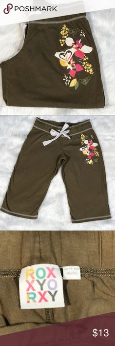 """XS Roxy Lightweight olive green board shorts Excellent condition Roxy Bermuda board short length shorts. Cotton blend and super soft with pink yellow and white Roxy symbols and hibiscus flowers on top left side. Olive green with white stitching and drawstring waist. Measurements taken flat* waist 13 1/2"""" rise 7 1/2"""" length 22"""" Roxy Shorts"""