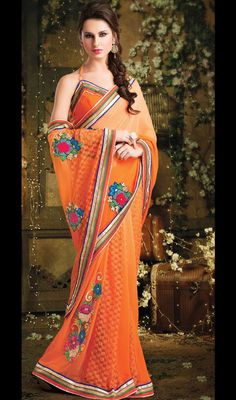 Deep Orange Georgette Embroidered Saree Price: Usa Dollar $108, British UK Pound £64, Euro80, Canada CA$117 , Indian Rs5832.