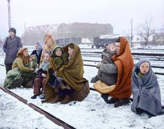 Survivors of the original 150 Polish citizens who walked from Lodz, Poland, Dec 14, 1945.  Huddling in blankets the only survivors of an original 150 Polish people who walked from Lodz in Poland to Berlin hoping to find food and shelter. They are waiting by a railway track hoping to be picked up by a British army train.