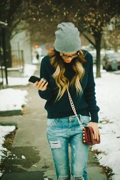 Ripped jeans and a beanie