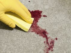 Don't panic if you get a blood stain on the carpet. Mixing mild liquid dish detergent with cold water, and blotting with a white rag, will help get the stain out.