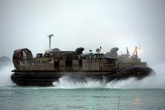 WHITE BEACH, Okinawa (Jan. 28, 2015) Landing Craft Air Cushion (LCAC) 9, assigned to Naval Beach Unit (NBU) 7, approaches the well deck of the amphibious assault ship USS Bonhomme Richard (LHD 6). Bonhomme Richard is deployed in the U.S. 7th Fleet area of responsibility. (U.S. Navy photo by Mass Communication Specialist 2nd Class Adam D. Wainwright)