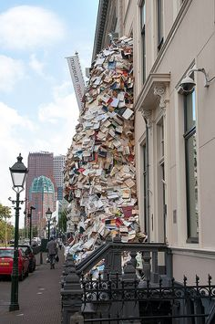 Sculpture of Hundreds of Books Cascading out of Museum Window
