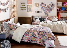 Bedroom: Multicolored Teen Girls Bedroom. teenage bedroom ideas. full color bedding. double bed. hanging wall art. dotted bedding. wooden shelving. wood flooring.