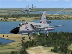 Delta Dart and F-15 Eagle Lining Up For Landing