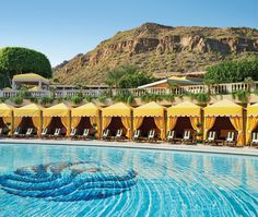 The pool at the Phoenician Resort in Phoenix, Arizona is lined with mother-of-pearl tile.