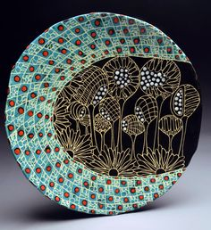 If you are looking for a cheap and creative way to add color and life into your interior, then look no further than ceramic plates. Rather than turning to expensive art pieces and portraits, you ca… Sgraffito, Pottery Plates, Slab Pottery, Ceramic Pottery, Ceramic Techniques, Pottery Techniques, Ceramic Decor, Ceramic Plates, Ceramic Painting
