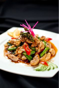 BAI TA PAU KAI - HOT BASIL CHICKEN. Get hot with our stir-fried boneless chicken with hot basil, green peppercorn, long bean and scallion.
