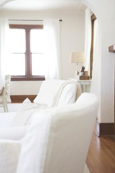 Creamy white walls, original wood trim, pretty :)