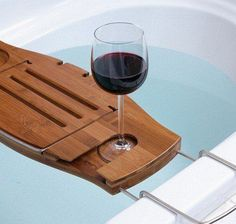 $49.99 Bamboo and Chrome Bathtub Caddy: Relax for hours in the tub with a book, glass of wine and bubble bath as this bathtub caddy has a book support that folds away when not in use and a spot to slip in and hold your wine glass securely. There is even a spot for your soap! The caddy is made of bamboo and will not split or mold. The arms of the caddy slide in after use for easy, compact storage.