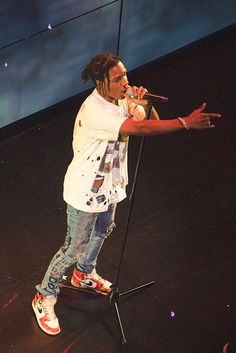 ASAP Rocky wearing  Himumimdead Custom Graffiti Jeans, Jordan 1 1985 Sneakers