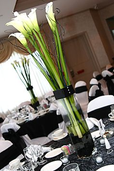Calla lilies centerpiece with white ribbon around the vase how centerpieces providence florist rhode island wedding flowers junglespirit Choice Image