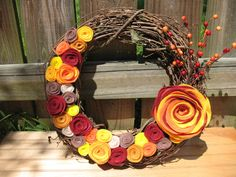 Rustic Fall Wreath -- Autumn Wreath--Thanksgiving Wreath--Fall Door Decor-Fall Decoration-14 inch Grapevine and Felt Flower Wreath. $34.00, via Etsy.