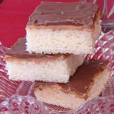 Tandy Cake Allrecipes.com  Ingredients  4 eggs 2 cups white sugar 1 teaspoon vanilla extract 2 cups all-purpose flour 1 teaspoon baking powder 1 cup milk 2 tablespoons margarine 1 1/4 cups peanut butter 2 pounds milk chocolate candy bar, chopped  for directions follow the link  http://allrecipes.com/Recipe/Tandy-Cake/Detail.aspx