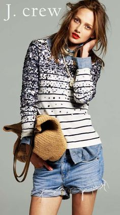Denim on denim covered by sequins on stripes. Can't stop staring at this sweater.