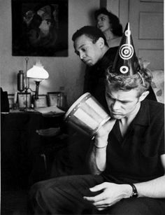 James Dean with Bill Gunn and Barbara Glenn, at a New Year's Eve party in Roy Schatt's apartment.