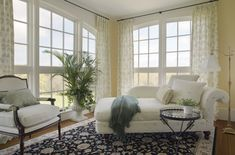 These unlined embroidered linen panels are hung from rings on diameter black iron rods with simple ball finials. While these panels and hardware are custom, a similar look may be achieved with ready made panels. Arched Doors, Transom Windows, Palladian Window, Beach Living Room, Living Rooms, Classic Living Room, Brass Floor Lamp, Drapery Rods, Window Treatments