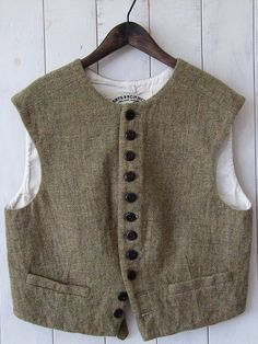 (ARTS&SCIENCE) In love with this vest. Warm, toasty, protective, securing, hidden, modest, complex and yet simple, buttons and lining! LOVE this, wonderfully eccentric like me.
