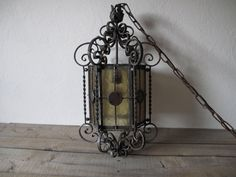 Vintage Wrought Iron Light. Vintage Hanging Light.  Stained Glass Light, Pendent Light.Amber, Red, Scrowl work iron, Hollywood Regency. $350.00, via Etsy.