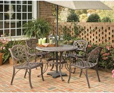 Home Styles Biscayne Brown Frame Patio Set at Lowe's. Home Styles Biscayne Set includes 42 inch Round Outdoor Dining Table and Four Arm Chairs. Set is constructed of cast aluminum with a Rust bronze Round Outdoor Dining Table, Round Dining Set, Patio Dining Chairs, 5 Piece Dining Set, Arm Chairs, Dining Sets, Outdoor Living, Patio Table, Picnic Tables