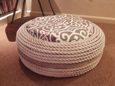 A great project as summer slows down, this versatile DIY rope ottoman will be a great addition to your living room or front porch. #DIY #tire #ottoman #rope #project