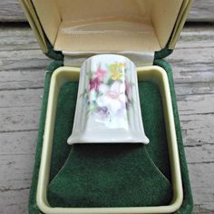 A beautiful vintage china thimble in original green box marked Donegal, Parian China.  Thimble measures one inch and shows a bouquet of flowers on two sides.  A wonderful collectible piece to add to any thimble or sewing collection.