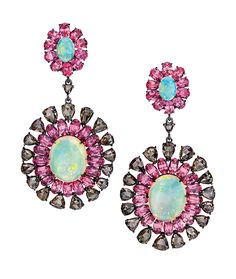 Cellini Jewelers Sutra Jewels Opal and Pink Spinel Earrings These eye catching opal (11.15ct) earrings are brought to life with the sparkle of 7.07 carats of rose cut brown diamonds, and the vibrant color of 11.15 carats of pink spinel.