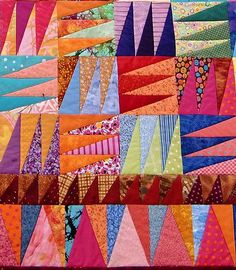 close up, Kaffe Fassett quilt by Linda in many colors. December 2012
