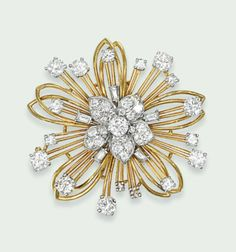 A DIAMOND BROOCH, MOUNTED BY CARTIER   Of stylised floral design, the central circular-cut diamond-set flowerhead, to a further polished openwork flowerhead surround, set with baguette and circular-cut diamond accents, 4.3cm wide  Signed Mtd. Cartier