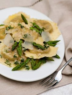 Put a twist on your ravioli by adding a white wine butter sauce with asparagus. #recipes #wine #pasta