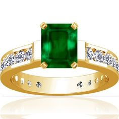 18K Yellow Gold Emerald Cut Emerald Ring With Sidestones