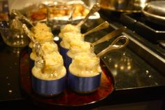 Baby shower idea-- cheddar mac n' cheese served in blue or pink ribbon wrapped baby food jars