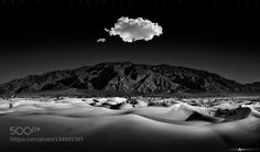 Mesquite dunes of death valley with the Amargosa Mountains in the distance. Curves patterns and shadows captured and contrasted in the moonlight. A single cloud hangs above serenading the evening landscape. Thank you so much for viewing! To follow me on Facebook please click here: Facebook Page You can visit my website by clicking here: www.mattandersonphotography.com You can also follow me HERE: Instagram | Google | Twitter Please E-mail me with any questions. 2015 Matt Anderson All Rights…