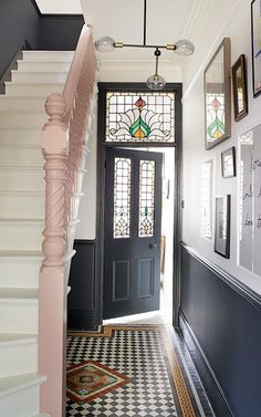 hallway decorating 707698528927993013 - 'I felt like the hall was very monochrome. It needed something extra,' says Alex, so she chose pink for the banister. Source by bookquotedecor Tiled Hallway, Hallway Ideas Entrance Narrow, House Entrance, Modern Hallway, Entrance Halls, Entrance Hall Decor, Modern Staircase, Staircase Design, Entryway