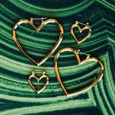- Set of 4 heart-shaped earrings, comes with two smaller hoops and two larger hoops - The hoops can be worn hanging together, or apart - Posts are hypoallergenic, won't irritate your ears - Made from