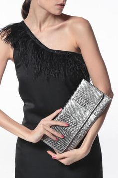 Designed with fauxleather and snake skin detailing to help with scratch resistance. Feastures a sliver chan and interior zip pocket.  Dimensions:30 L x13 W  Envelope Clutch by NAMES Accessories. Bags - Clutches Canada