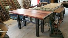 Custom Pub table made with African Padauk, banded steel edges, and our signature steel base. Simply Stunning!