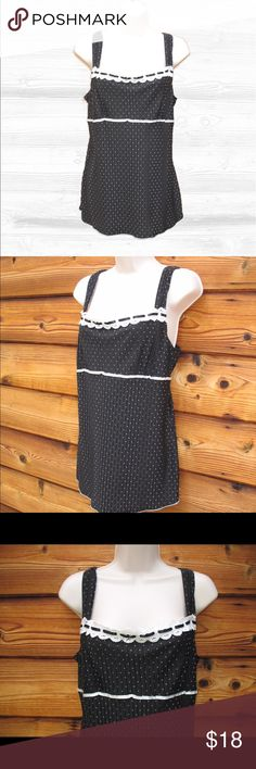 "Volume 1 Pleated Tie-Back Lace TRim TOp Volume 1 Pleated Tie-Back Lace TRim TOp  *Excellent condition. No signs of use.  Details: Volume 1 Color: Black/White Size: Juniors XL Pullover style Satin tie-back ribbon Eyelet lace trim Empire waist Pleated material 100% Polyester  Measurements: Length: 27"" Bust: 38"" Waist: 34"" Volume 1 Tops Tank Tops"