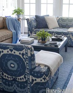 """Dark blues in the family room are """"sippy-cup-proof,"""" Wolf says. The print is Schumacher's Samarkand Ikat."""