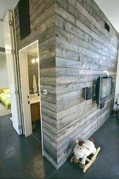 Wood wall. I love this idea...I wonder how hard it is to do and upkeep.