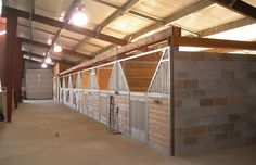 cinder block stalls - LOVE the clean-ability factor to brick/stone stalls walls, but all that stone is really expensive...