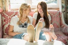 https://media.gettyimages.com/photos/laughing-teen-girls-at-home-with-phone-picture-id542743989