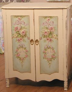Leave my armoire as-is except add pale aqua within the centers which are already outlined with flourishes.  And paint over the gilt cornice?