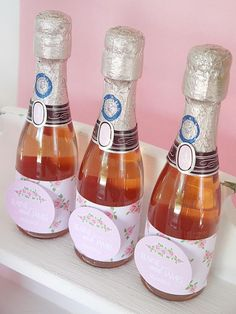 A Toast to the Happy Couple Miniature pink champagne bottles are a hit at the bar, and can be cute, adult-friendly favors, too. Wrap each bottle with a rectangle of printable scrapbook paper and add a personalized tag to the front.