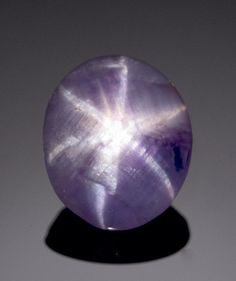 Purple Star Sapphire  Sri Lanka   This strong unusual sapphire is notable for its strong violet purple hue infrequently seen amongst sapphires. The asterism is both strong and central and the stone is of a suitable depth for ease of mounting.   Weighing approximately 3.79 carats and measuring 10.8 x 9.0 x 3.5mm