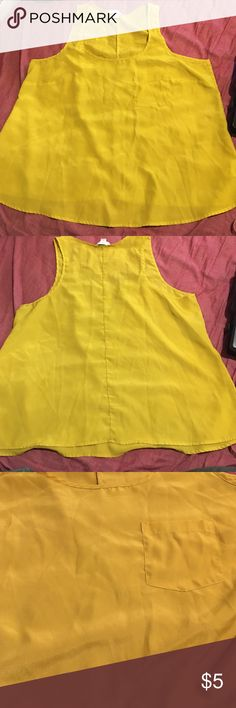 Forever 21 Mustard Yellow Tank with Pocket 2X Preowned, good condition, size 2X. It is a yellow color (it isn't as yellow in the pics). A silky satin like material, with front pocket. 100% Polyester. Small spot close to the pocket (shown in pictures), may or may not come out. Not very big at all. Measurements are approximate and laying flat. Armpit to armpit 23 inches. Length is 25 inches,taken from back. Please see photos, comments and ask questions before purchase. PRICE IS FIRM BUNDLE AND…