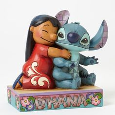 Ohana Means Family. Lilo and Stitch come together in an exemplary display of Ohana… which means family. A great piece that shows it doesn't matter who you are. Part of the Disney Traditions collection by Jim Shore.