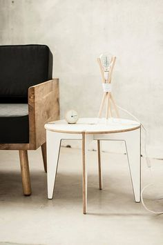 A modern side (or coffee) table in a clean, minimalist design.