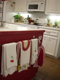 beadboard, red, and with a towel rod full of vintage dishtowels.  Perfect....so doing this at the end of my counter...mine is painted black....love this